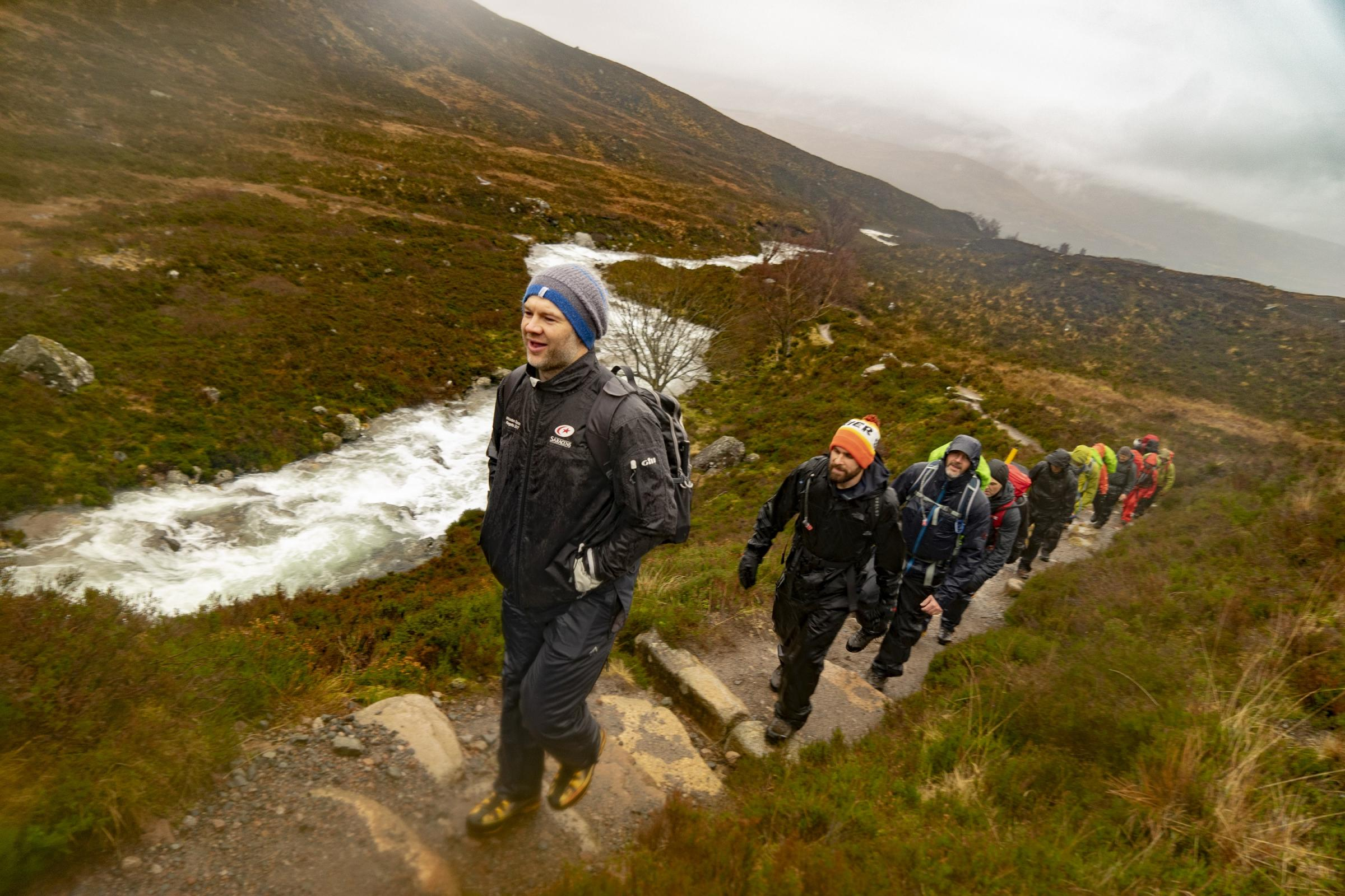 Former IRB World Sevens Player of the Year Ollie Phillips leads the group up Ben Nevis