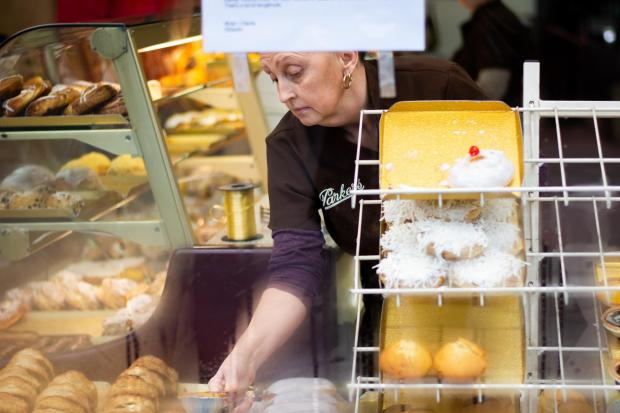Ealing Times: Jackie Keenan, Parkers employee, seen through the bakery window, with the closure sign hanging over her head. Northfield Avenue, February 2019.