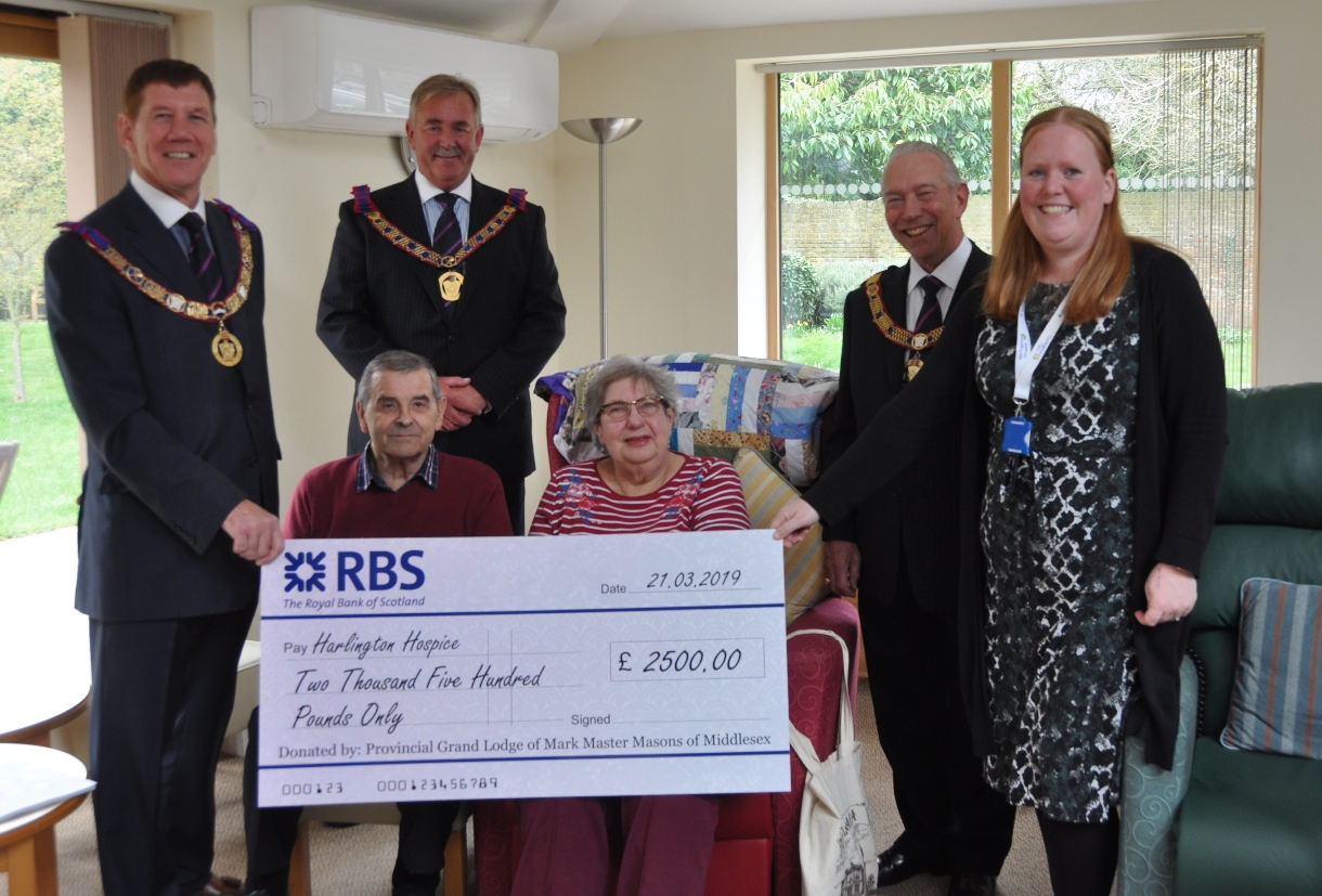 Cheque it out: Eddy Garty and colleagues at the hospice