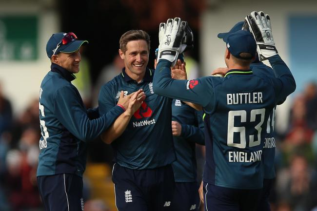 Chris Woakes, centre, celebrates his five-wicket haul
