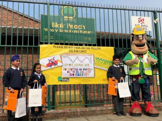 All our own work: pupils with their banner at Blair Peach School